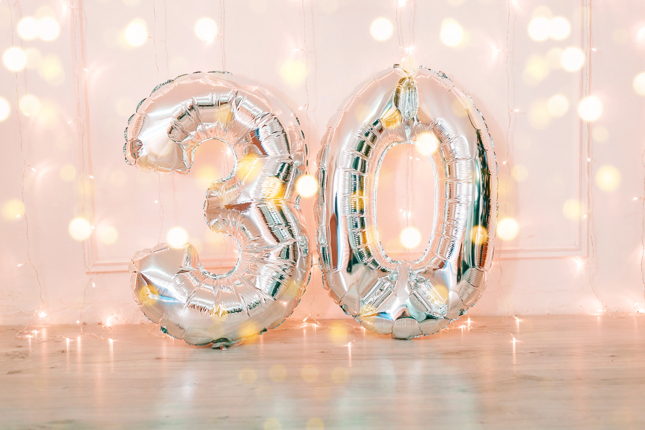 Silver balloons that say 30 and twinkle lights