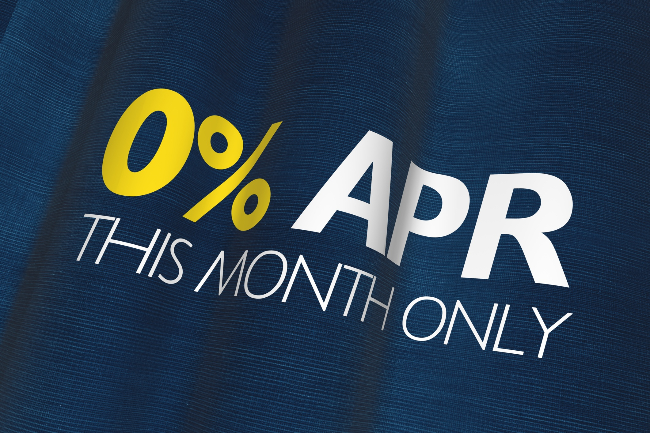 A blue sign that reads zero percent APR this month only.