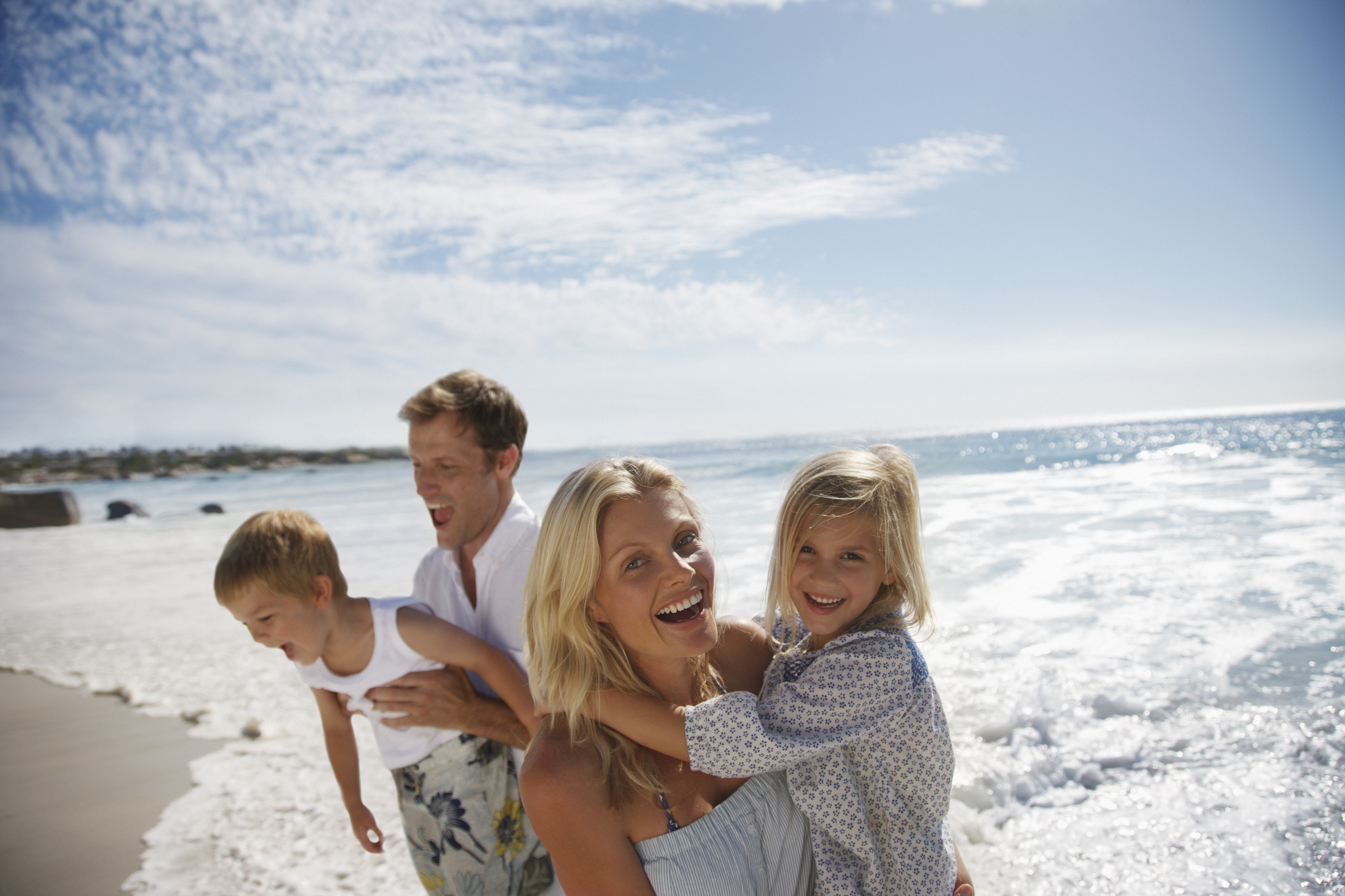 Man, woman, young boy, and young girl at the beach