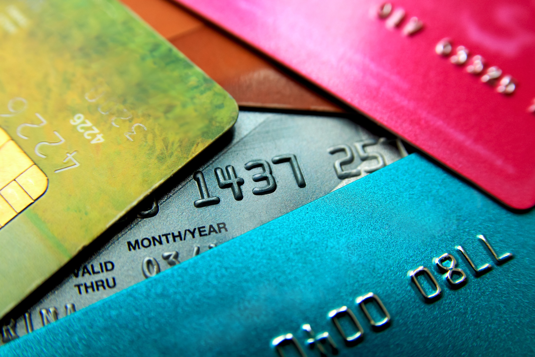 Pile of credit cards in multiple colors