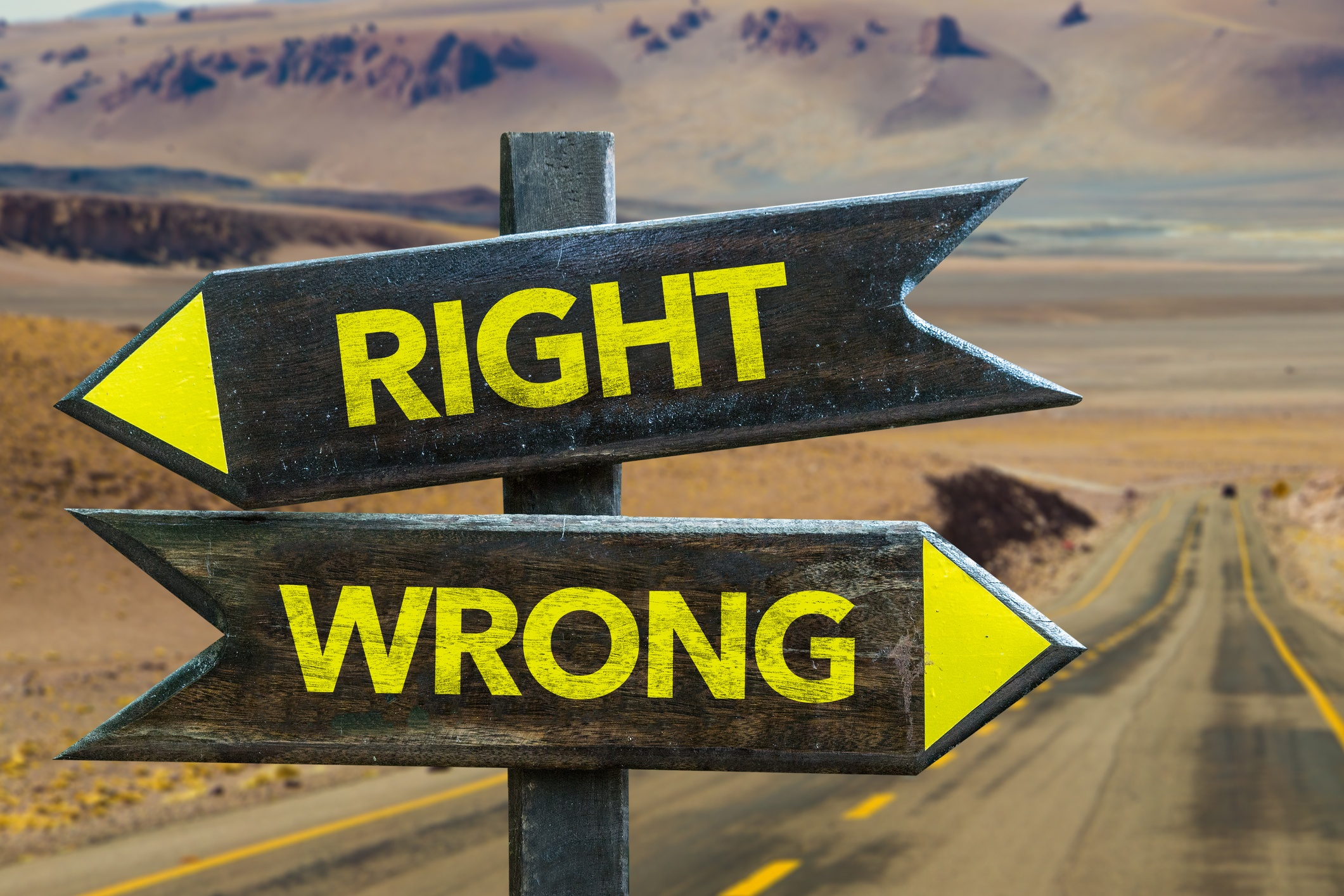 "two arrows on a road sign, one saying ""right"" and the other saying ""wrong"""