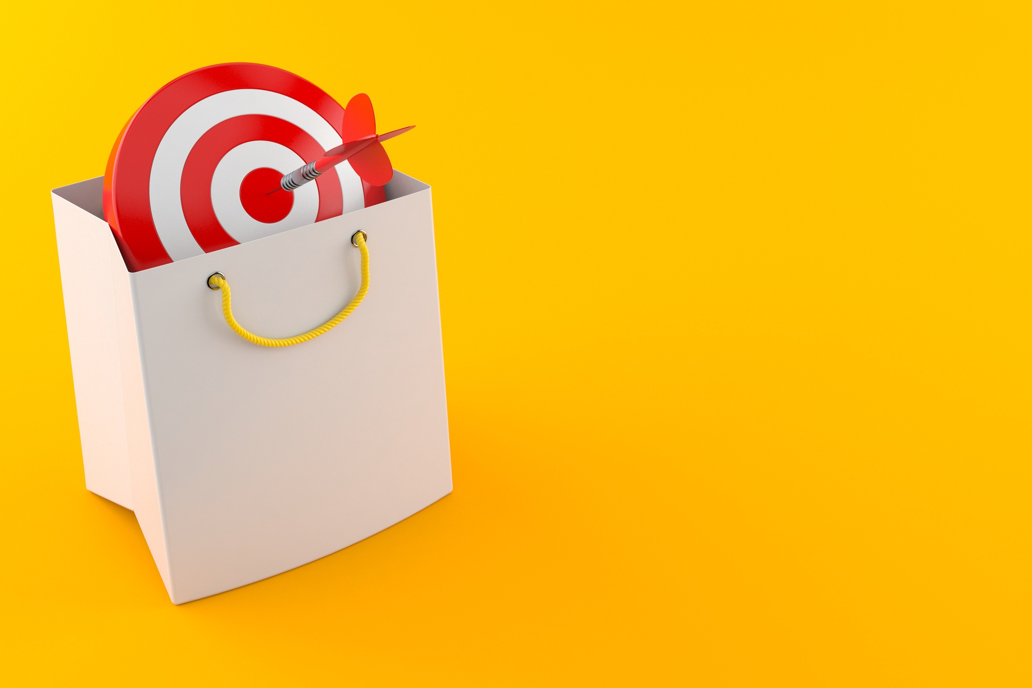 A target in a shopping bag with a dart in the bullseye