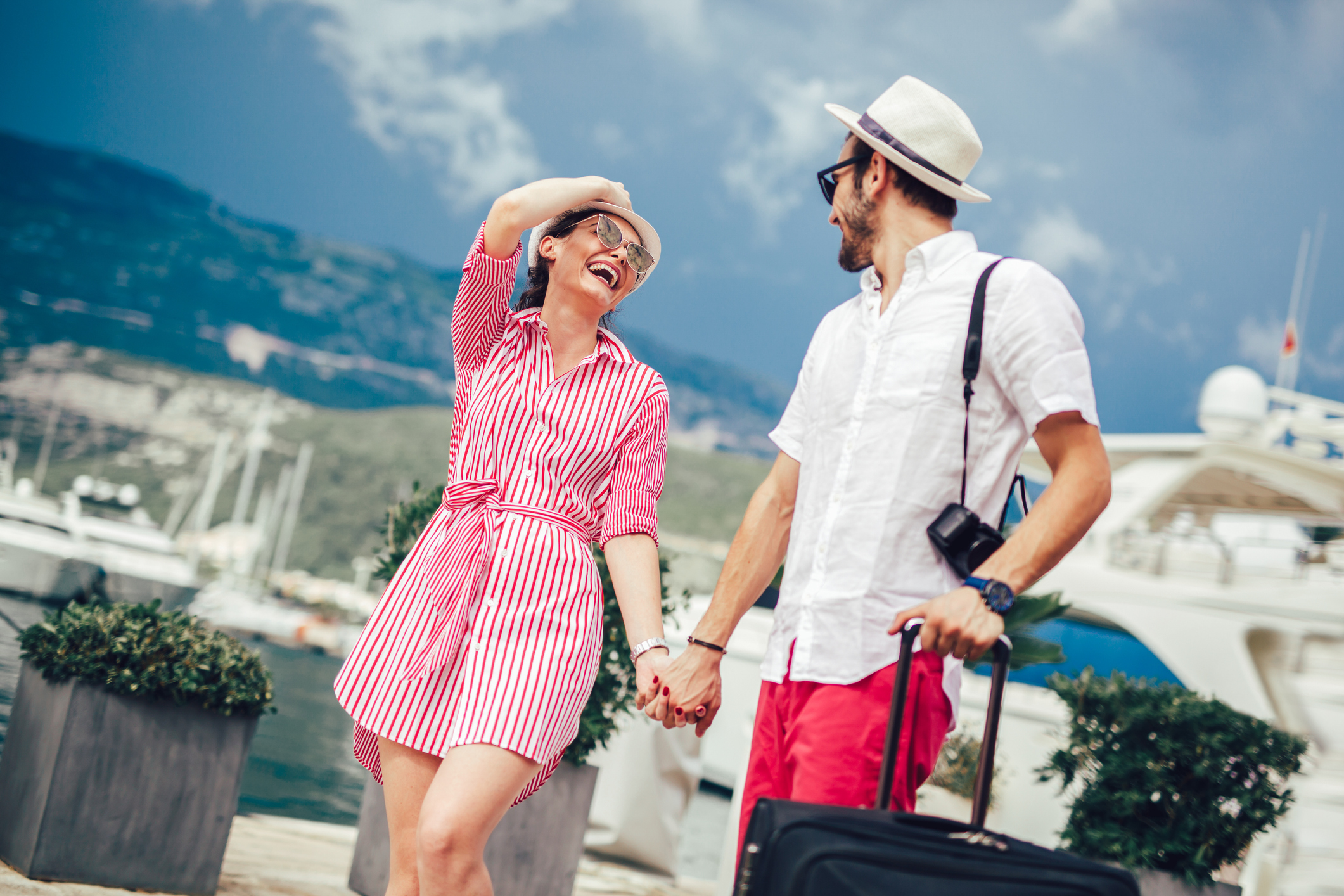 Couple in their 30s smiling while traveling.