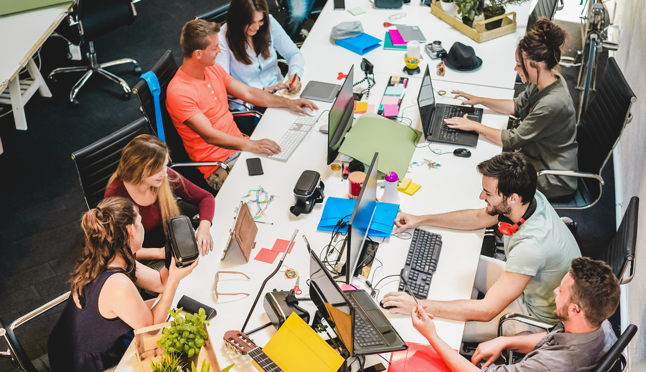 A group of young employees in an open office setting.
