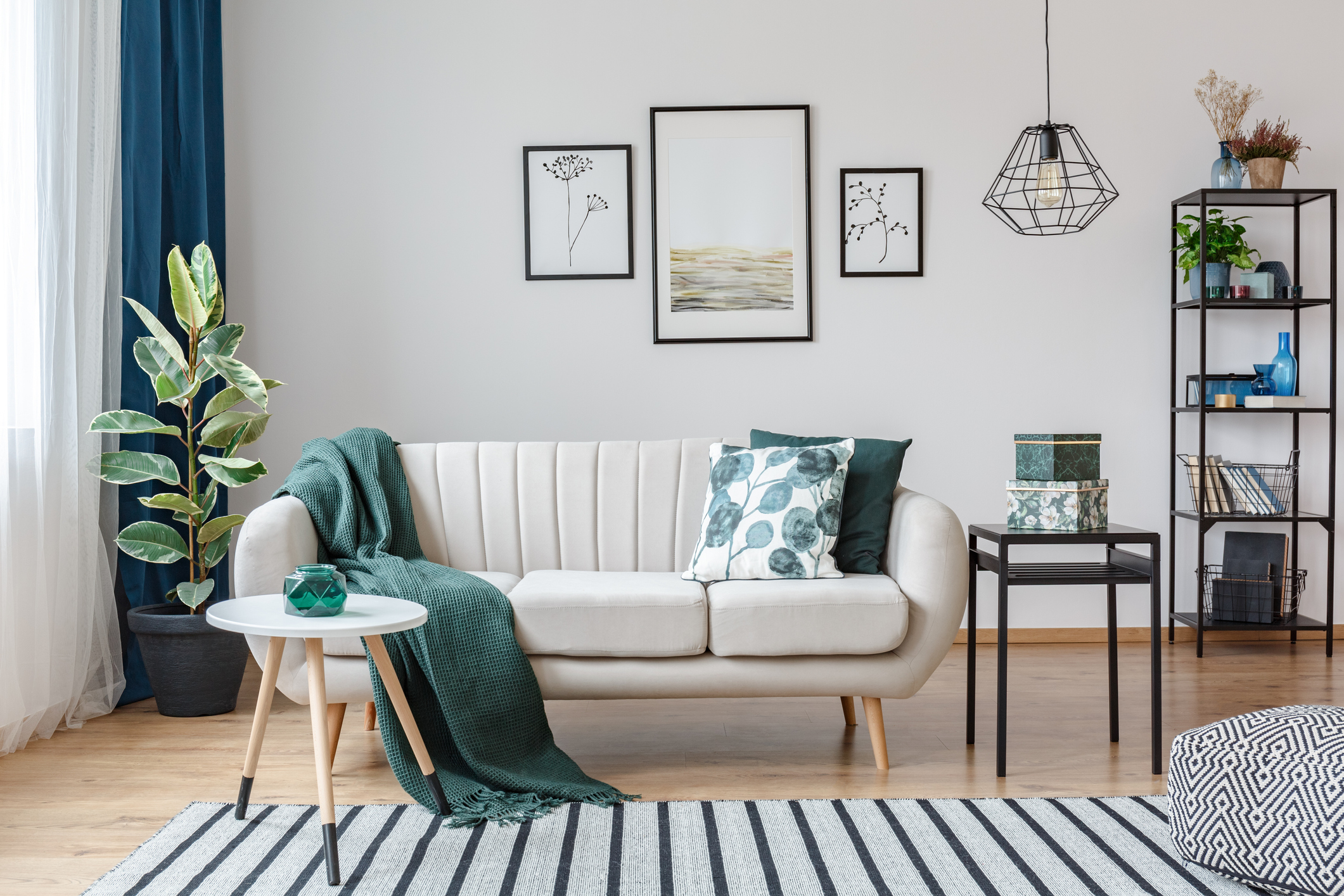 A stylishly decorated living room with green, black, and white accents.
