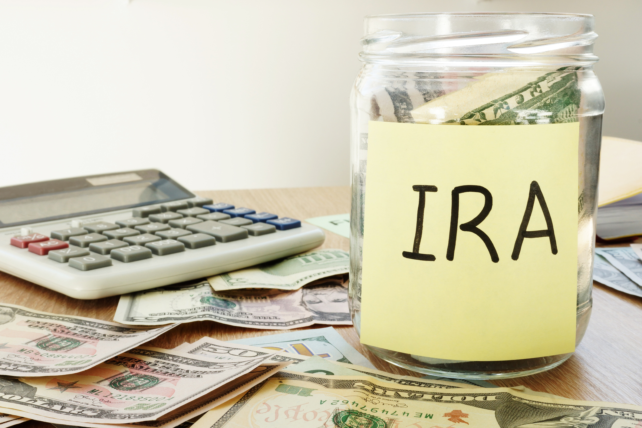 "Jar With ""IRA"" Filled With Money"