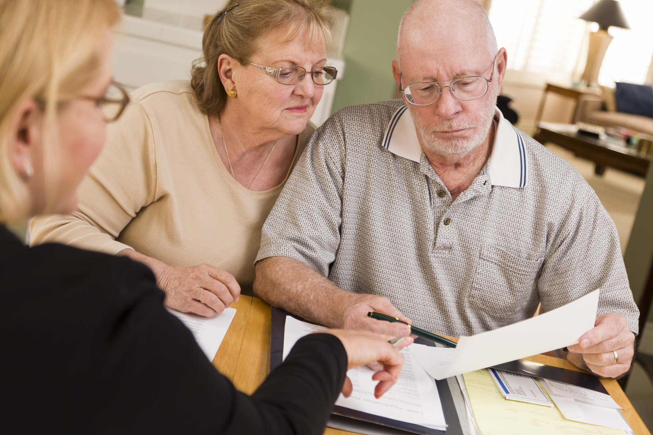 Older couple looking at financial paperwork
