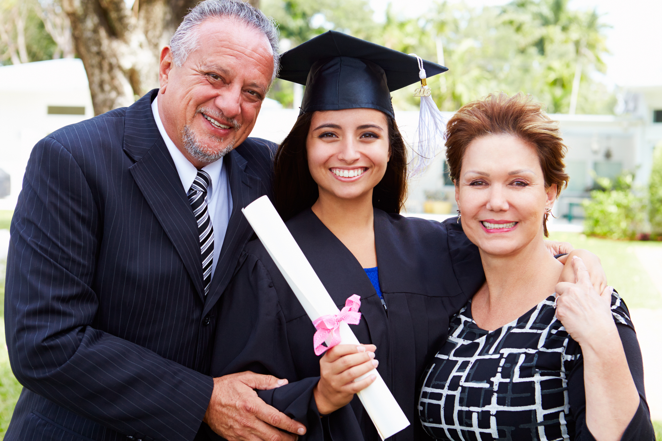 Parents with college student at graduation