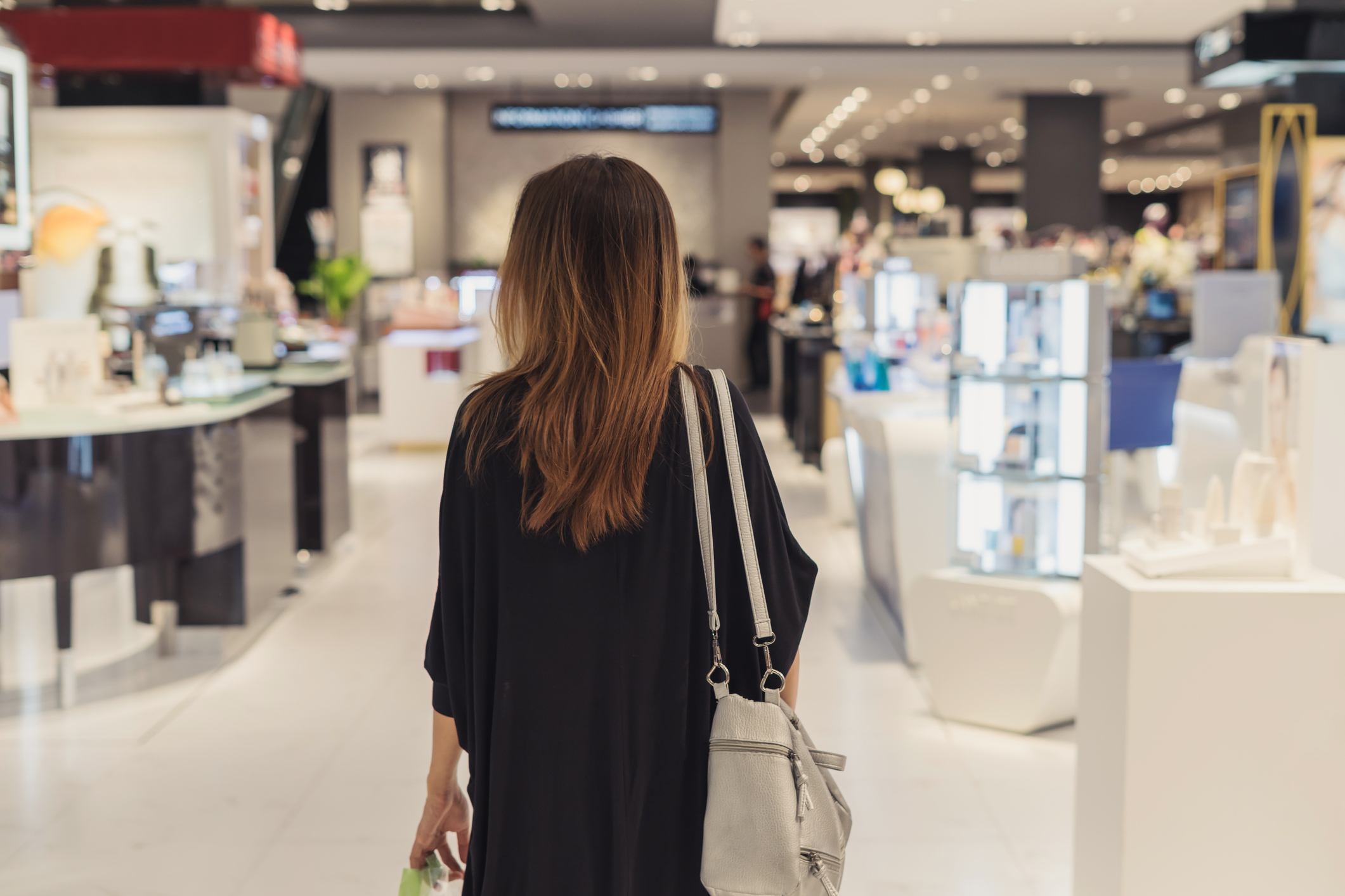A woman shopping in a department store.