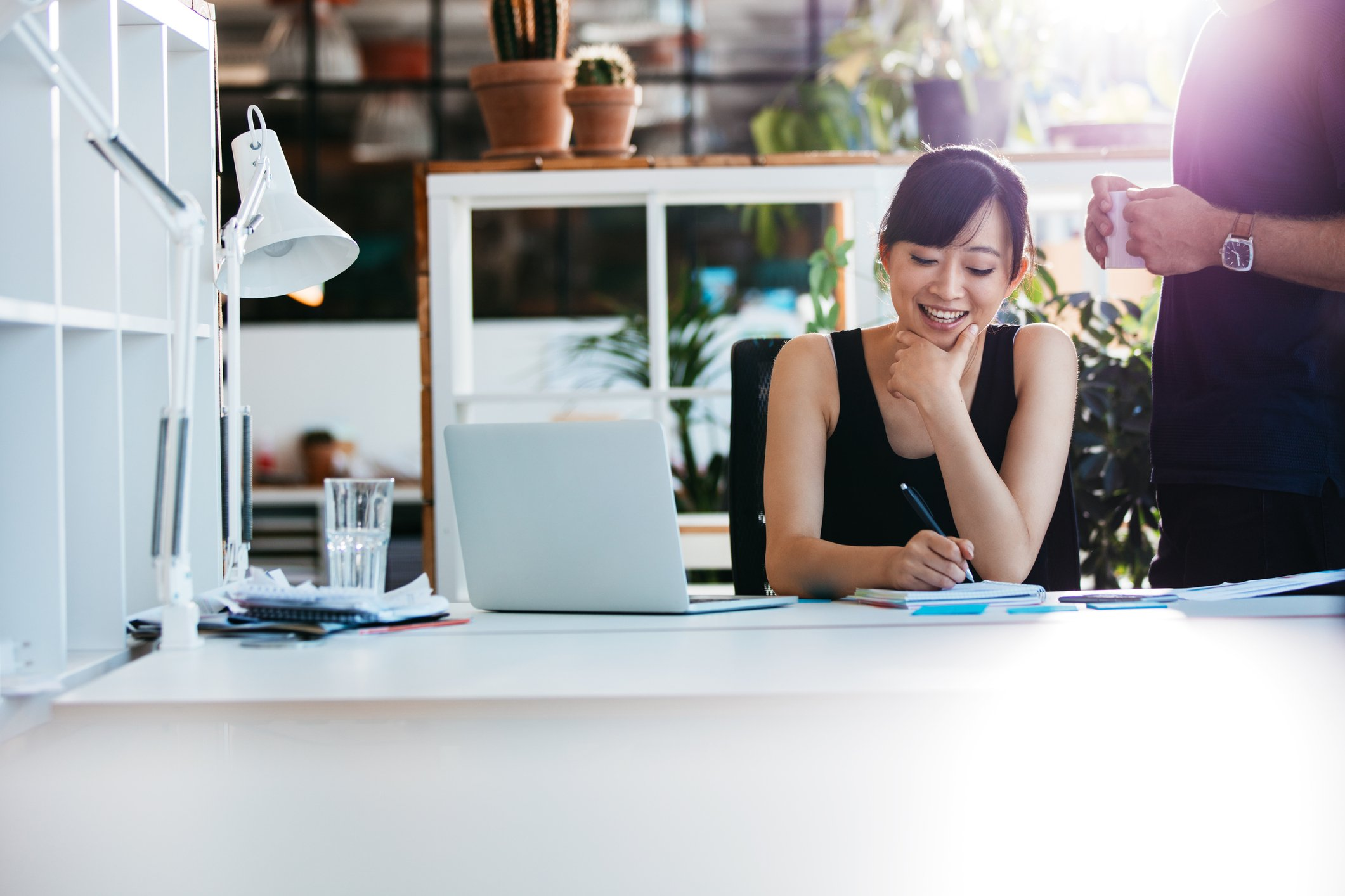 Smiling woman working in a bright office.