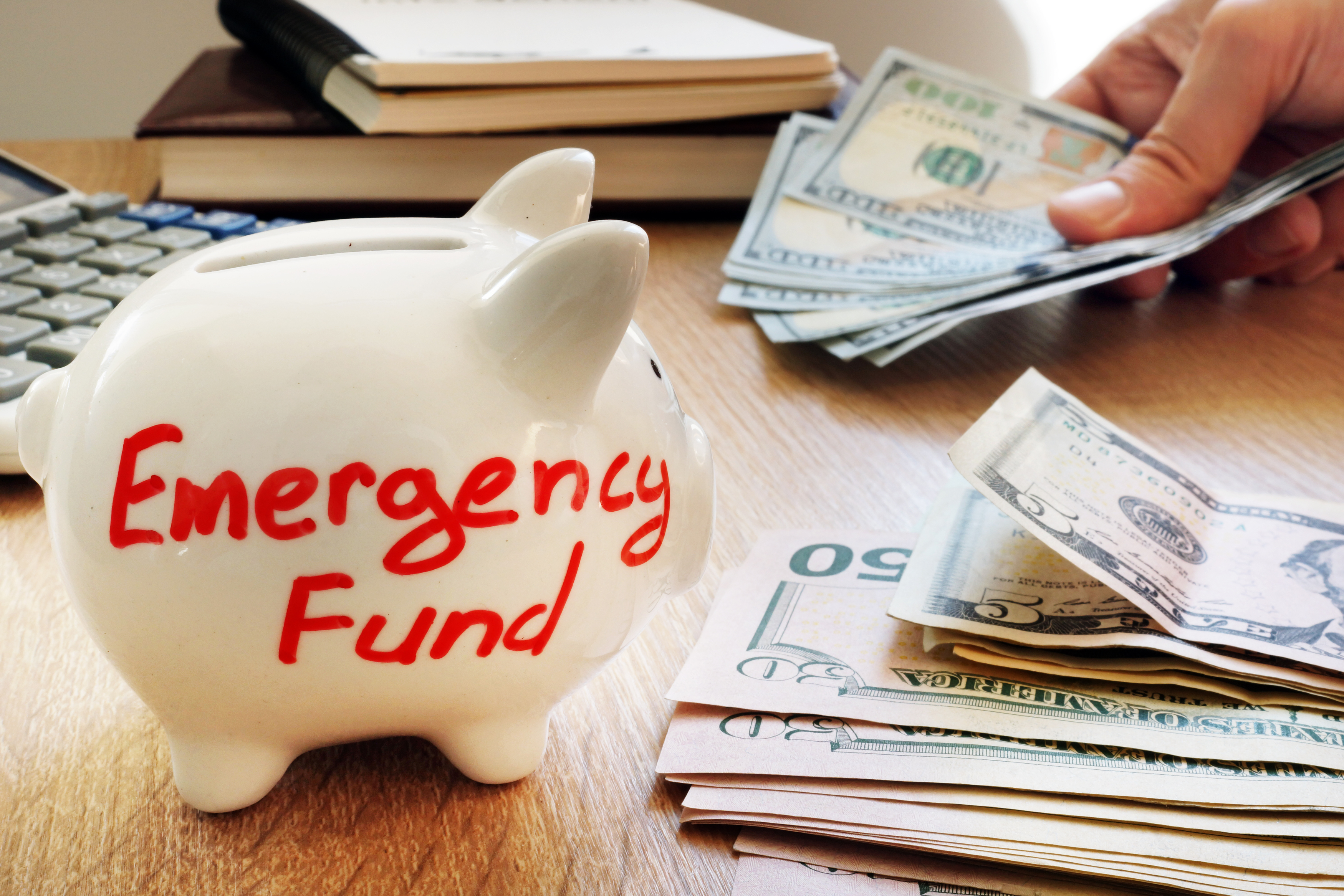 """Piggy bank with """"emergency fund"""" written on it"""