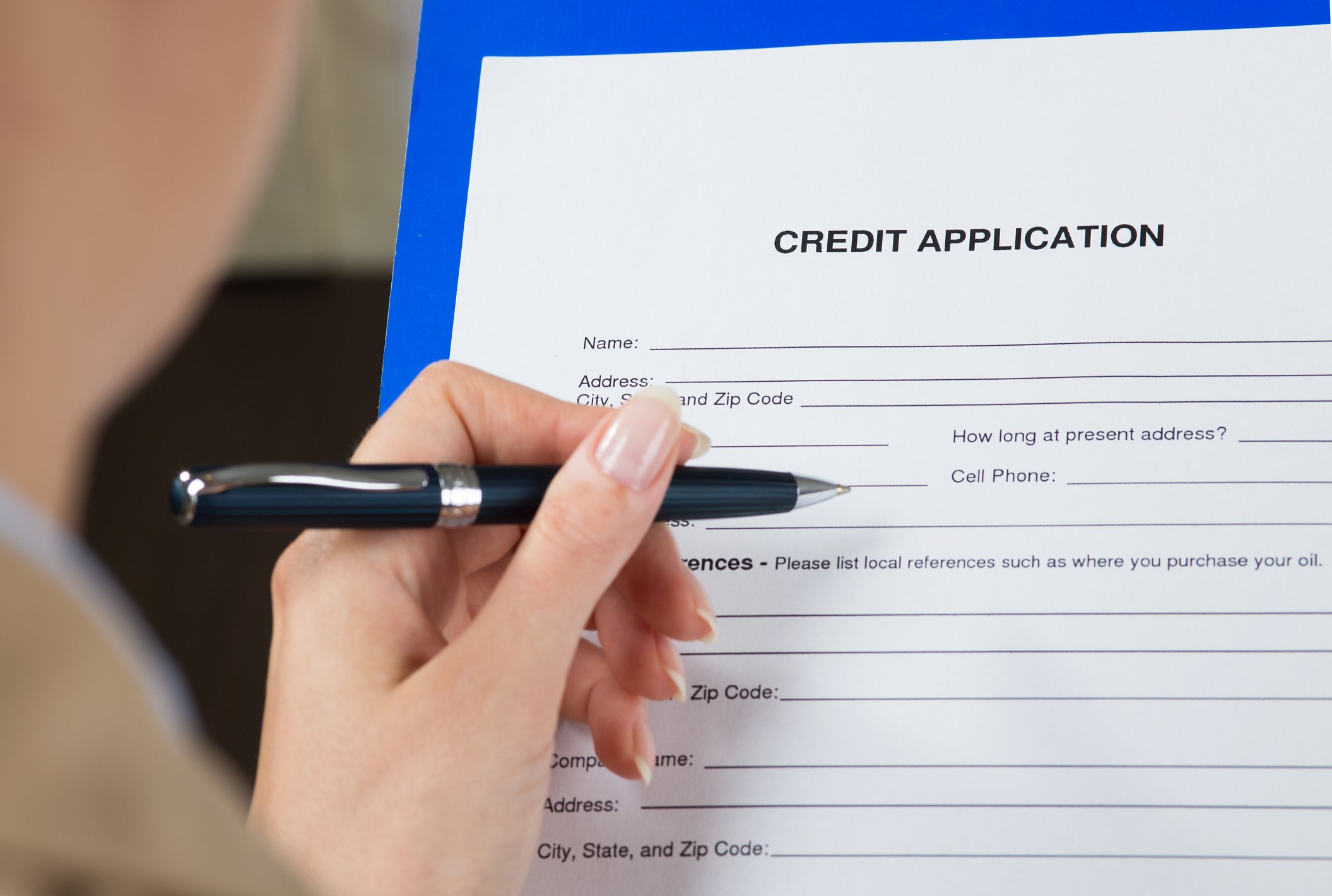 Woman filling out credit application.