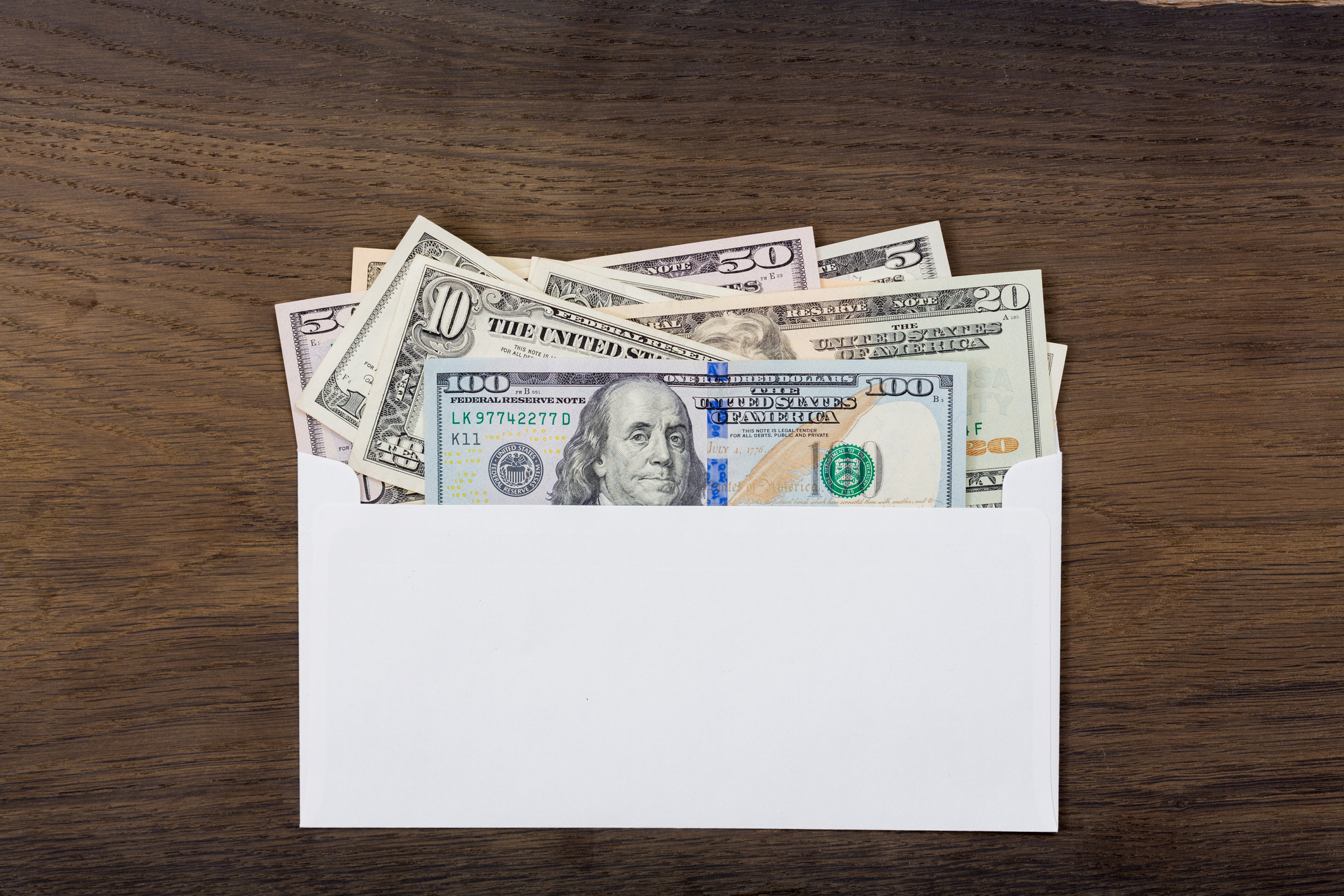 An envelope with various bills sticking out