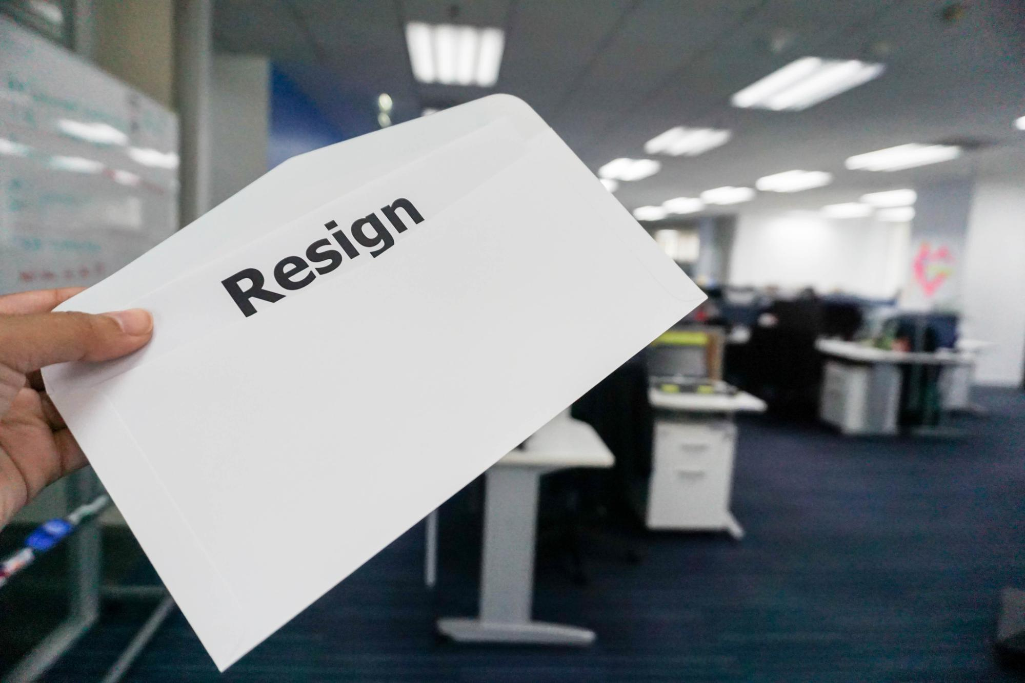 envelope with the word resign printed on it