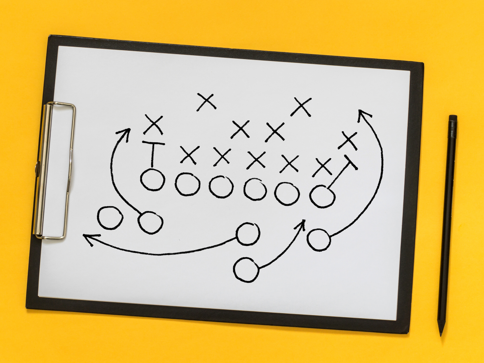 football play drawn out on clipboard