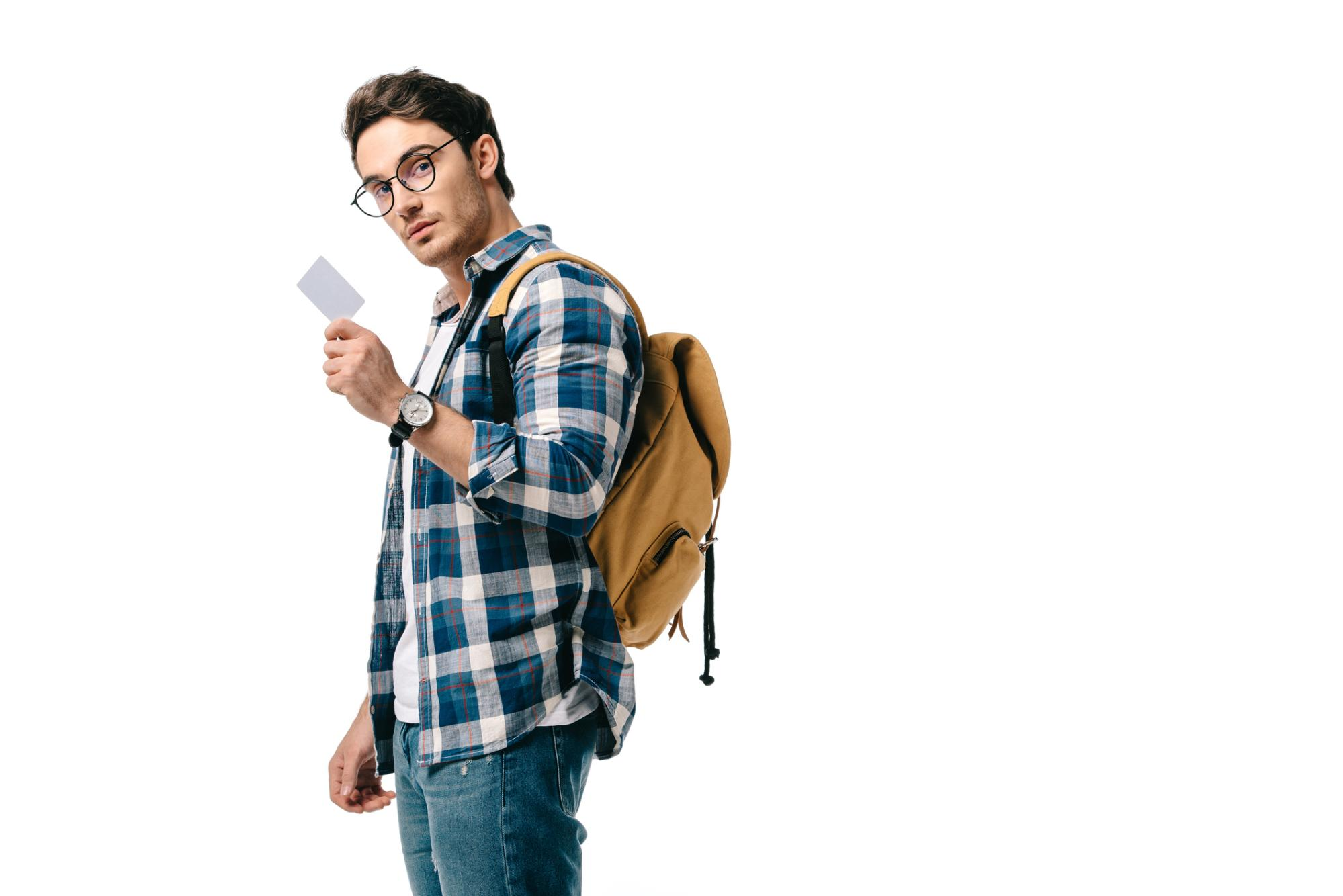 hip, bespectacled young man looking straight at you while brandishing a small white card