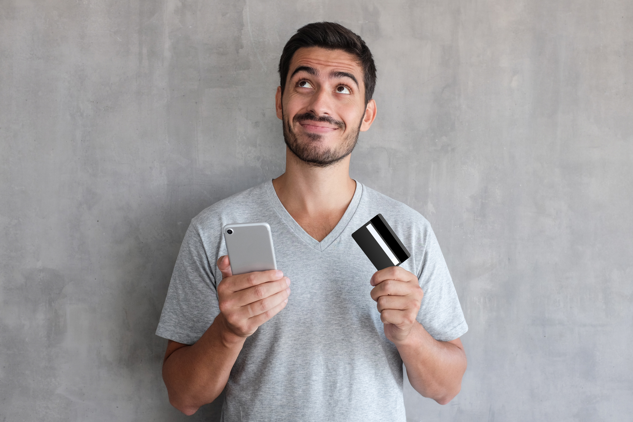 Man with credit card and cell phone