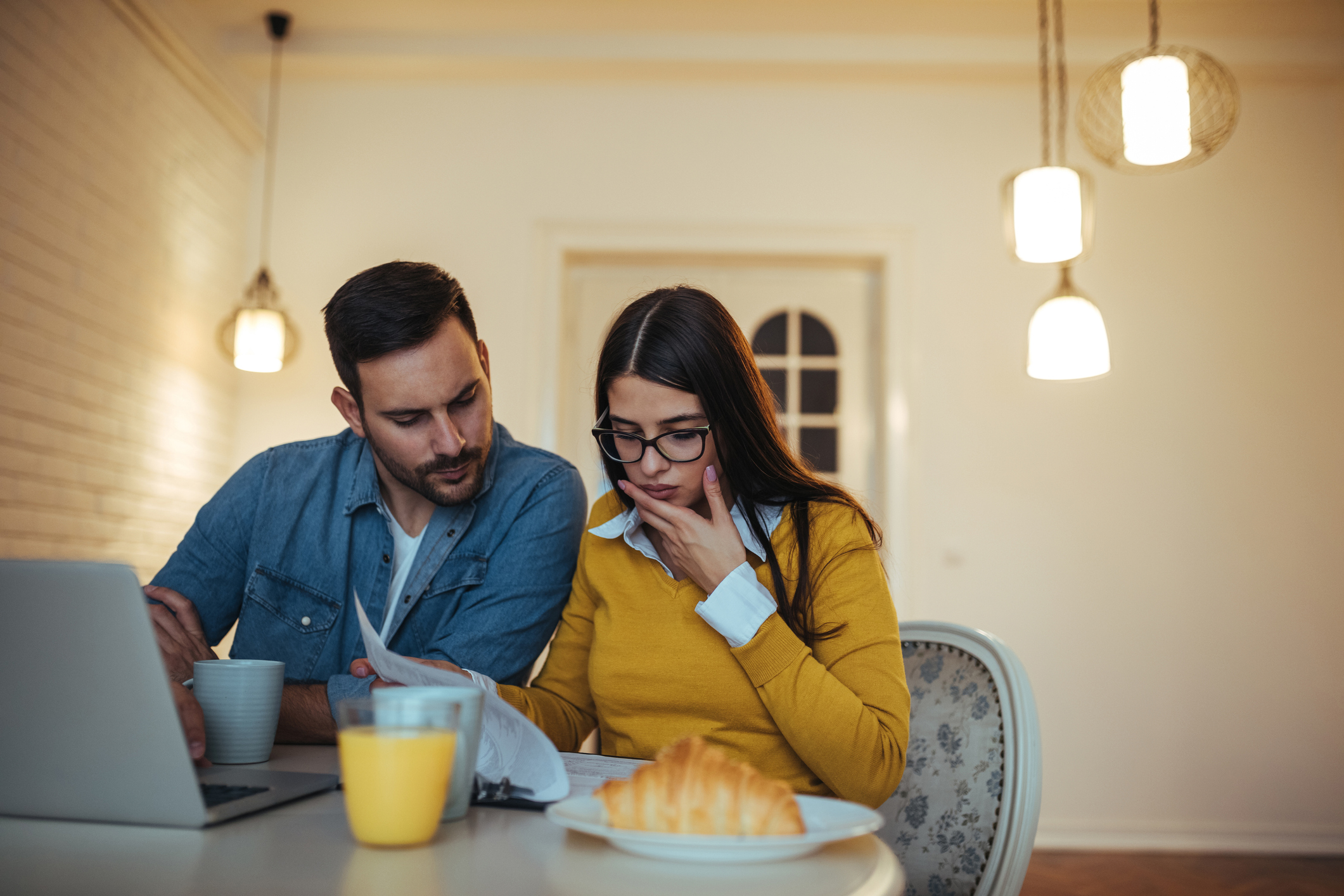 Man and woman looking at credit report