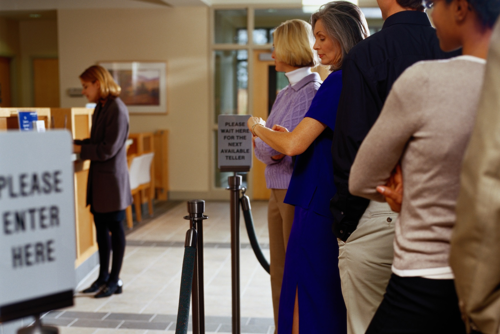 people waiting in line at a bank.