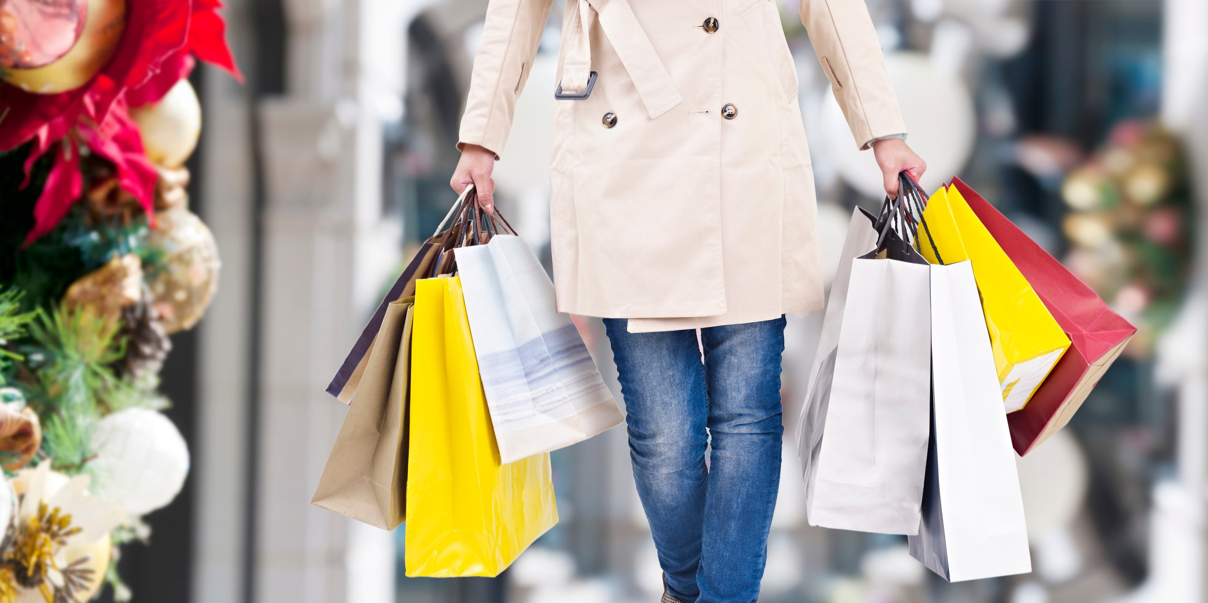 Woman carrying shopping bags during the holiday season.