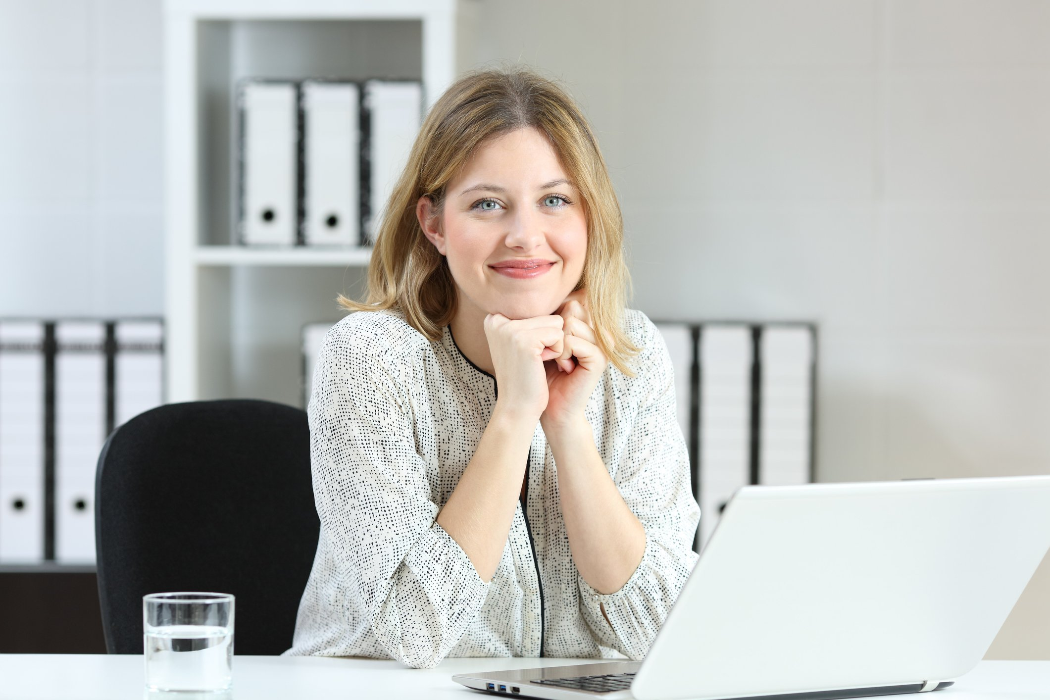 Smiling young woman at laptop