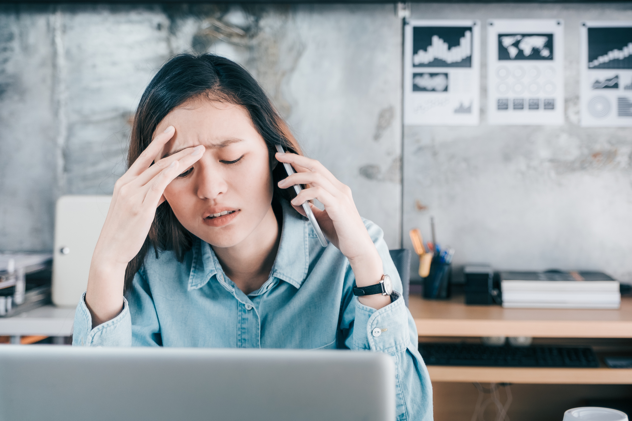 Stressed woman on the phone