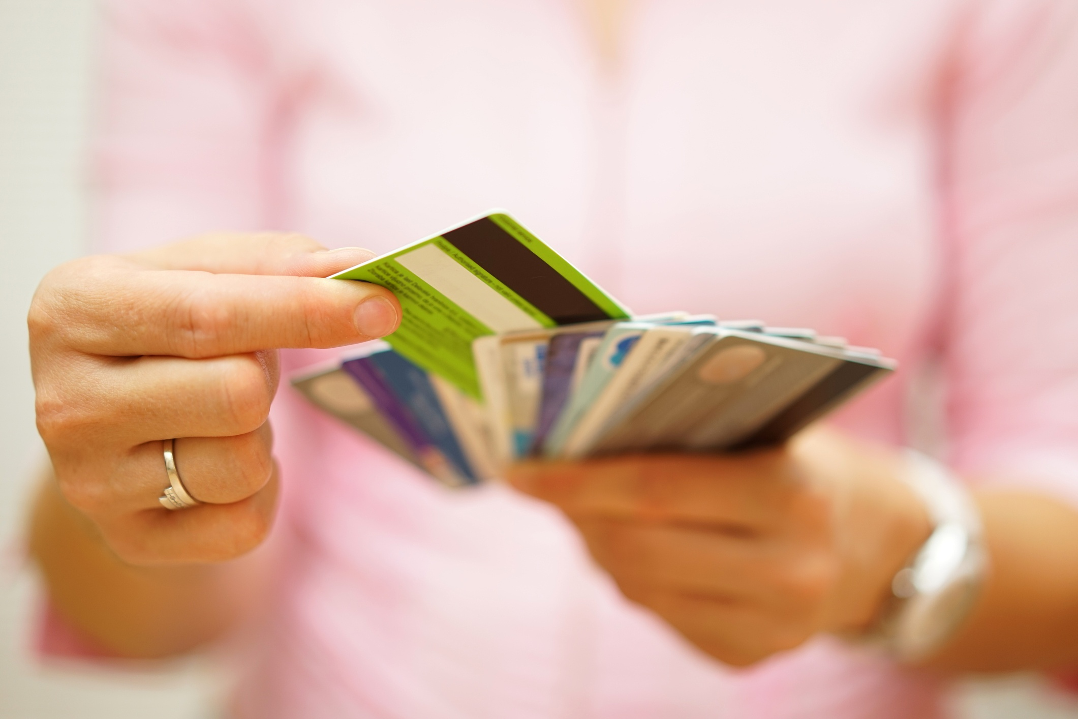 woman selecting credit card