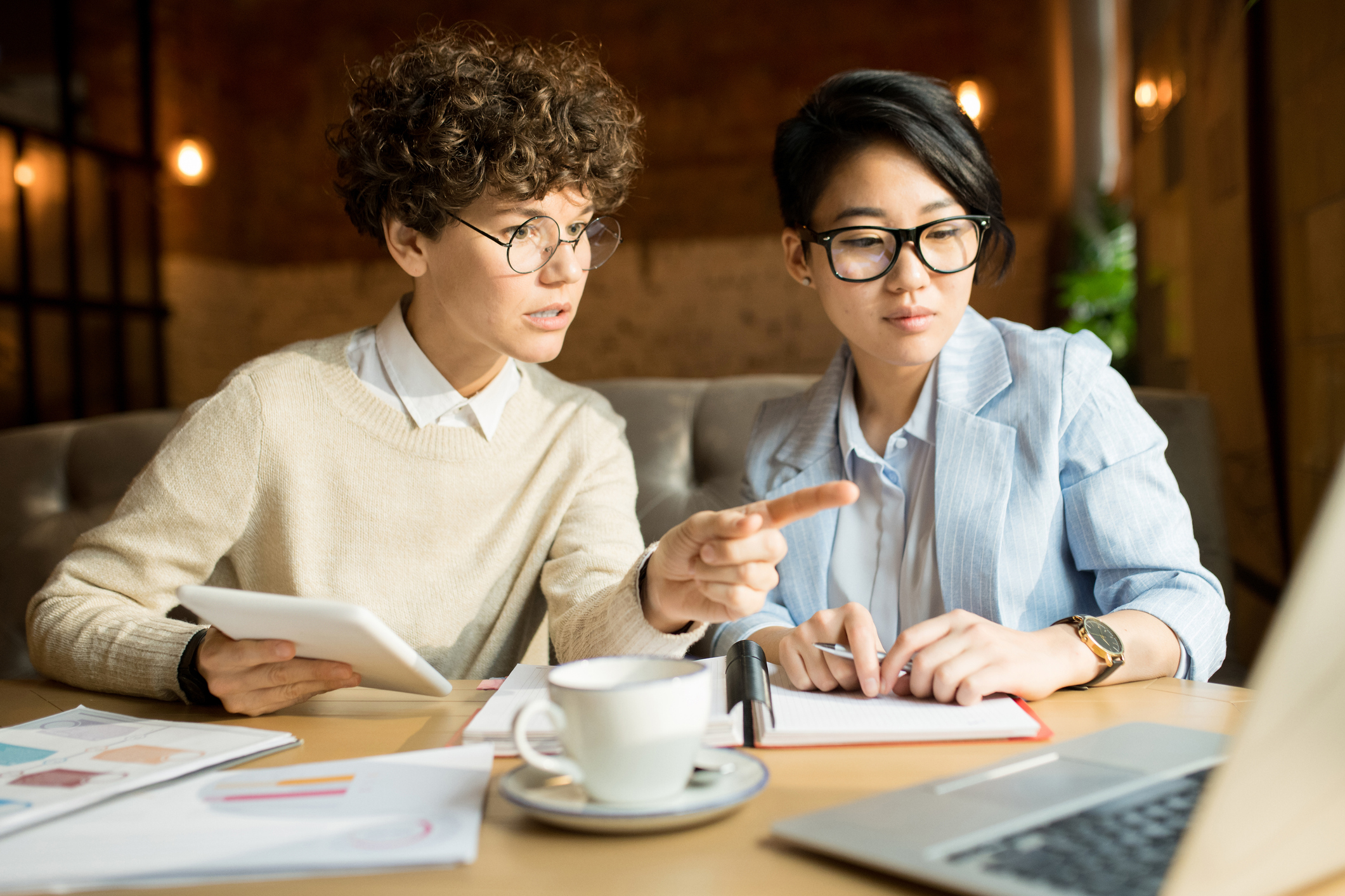 two women discussing the details of a personal loan